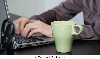 A woman poured tea onto a laptop. works in the office, - A...