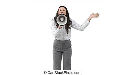 A woman roaring through a megaphone against a white...