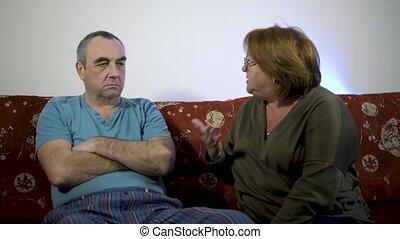 A woman scolds a man, a family quarrel.Couple of seniors arguing.