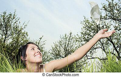 Woman sending handkerchief on the air