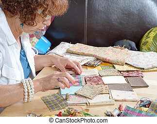 a woman sewing a patchwork