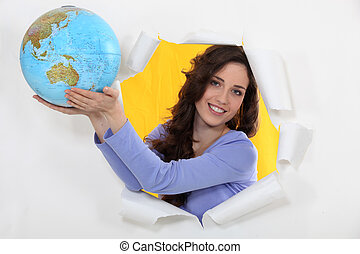 a woman showing a globe
