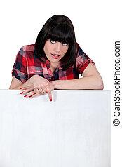 a woman showing a white panel