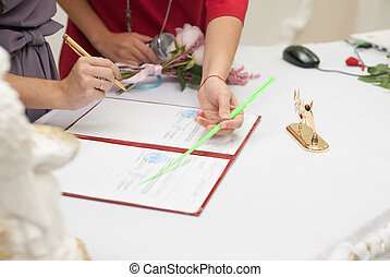 A woman signing a marriage contract,