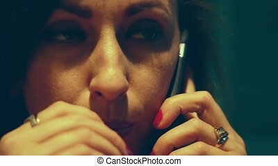 A woman solves problems by talking on the phone.