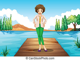 A woman standing above the wooden bridge at the river