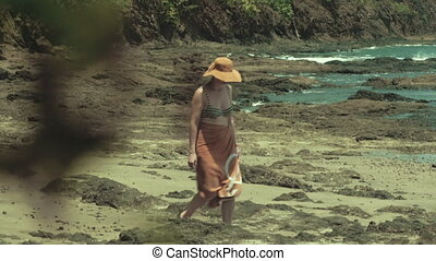A woman taking a long walk on the beach - A woman enjoys a...