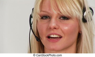 A woman taking on a headset