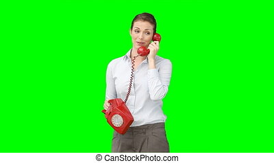 A woman talking on the telephone