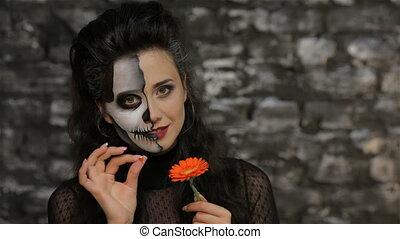 A woman tells fortunes tearing petals