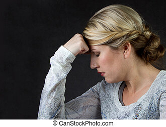 a woman thinking or with a headache
