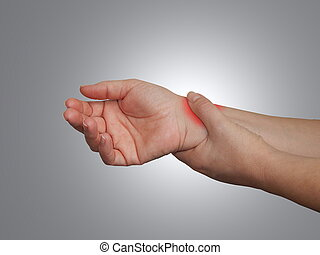 A woman touching her painful wrist.