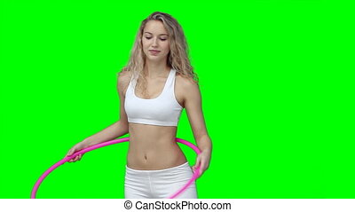 A woman tries her best to use a hula hoop