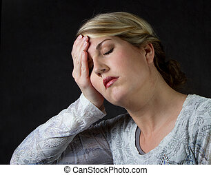 a woman upset or with a headache