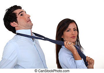 A woman using her boyfriend's tie as a leash.