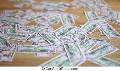 a woman walks through the heap of money