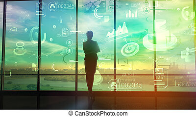 A woman watches charts and data of business processes