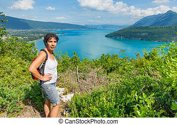 woman watching view of Lake Annecy - a woman watching view...