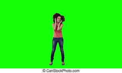 A woman wearing headphones is dancing