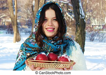 A woman with a basket of apples