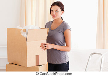 A woman with a cardboard