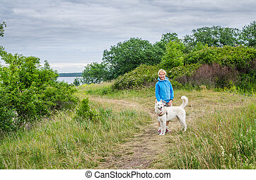 woman with a dog on the beach