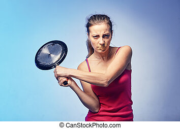 A woman with a frying pan in her arms. She does not want to ...