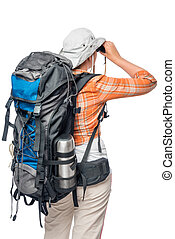 a woman with a large backpack is back and looking in binoculars