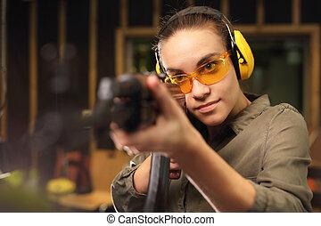 A woman with a machine gun