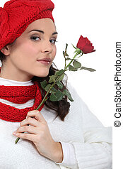 A woman with a rose.