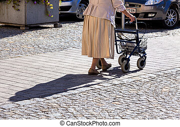 woman with a walker - a woman with a walker goes on the road...