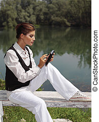 a woman with laptop in park zzx