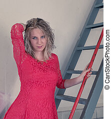 Woman with red dress on ladder