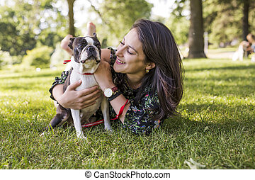 woman with terrier dog outside at the park