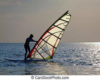 A women on windsurf