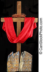 cross - A wood cross with a white red with Ten Commandments