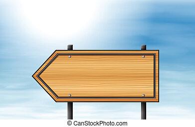 A wooden arrow signboard