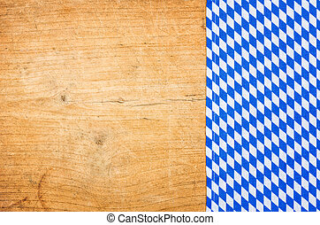 A wooden background with a bavarian tablecloth