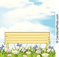 A Wooden Banner in Flower Garden