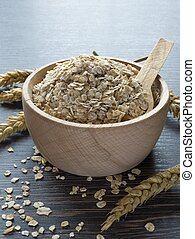 A Wooden Bowl of Oat Flakes