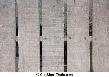 A wooden bridge on the beach.