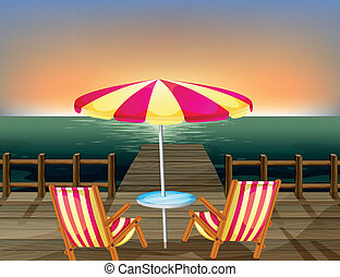 A wooden bridge with an umbrella and chairs
