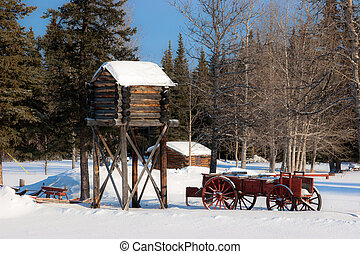 A Wooden Cache and Old Wagon