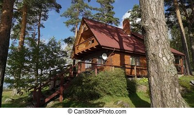 A wooden cottage near lake or sea. Luxury house for...