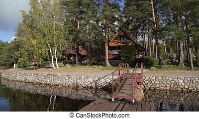 A wooden cottage near lake or sea. Luxury house for vacations
