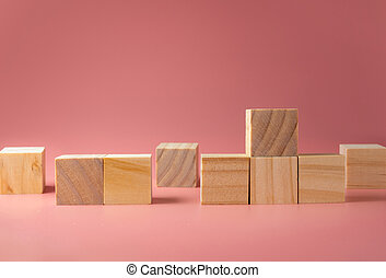A wooden cube on a pink background. For new ideas to be put into the picture.