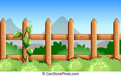 A wooden fence with green plants