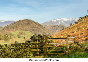 A wooden gate on a hillside in the English lake District ...