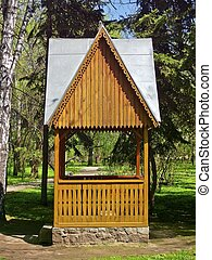 A wooden gazebo in the park