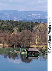 A wooden hut on a lake